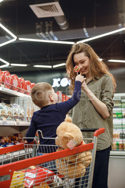Vertical image of mother and son with candys Stock photo © deandrobot