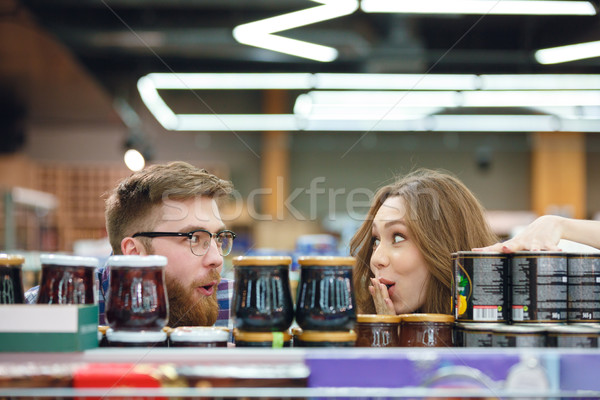 Couple looking at each other surprisely near jams in mall Stock photo © deandrobot