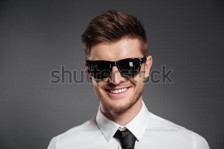 Сток-фото: портрет · улыбаясь · человека · Солнцезащитные · очки