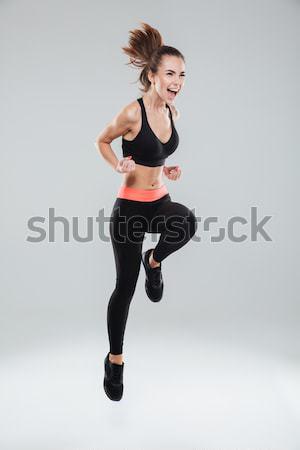 фотография кричали Фитнес-женщины серый женщину Сток-фото © deandrobot