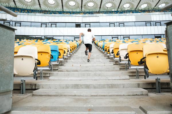 вид сзади молодые спортсмен работает наверх стадион Сток-фото © deandrobot