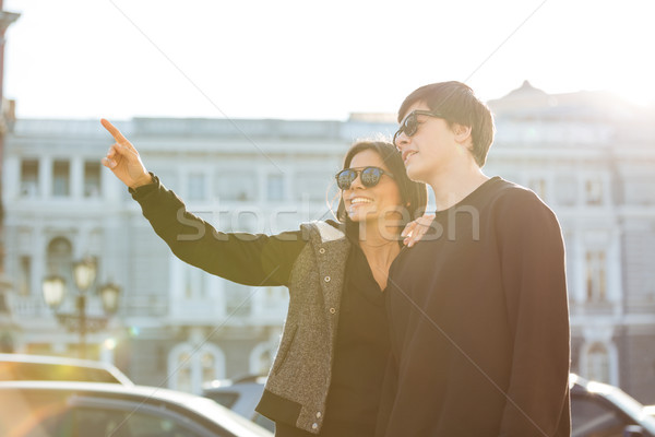 Pretty young lady walking outdoors with her brother. Stock photo © deandrobot