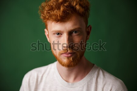 Close-up portrait of curly redhead young man with beard Stock photo © deandrobot