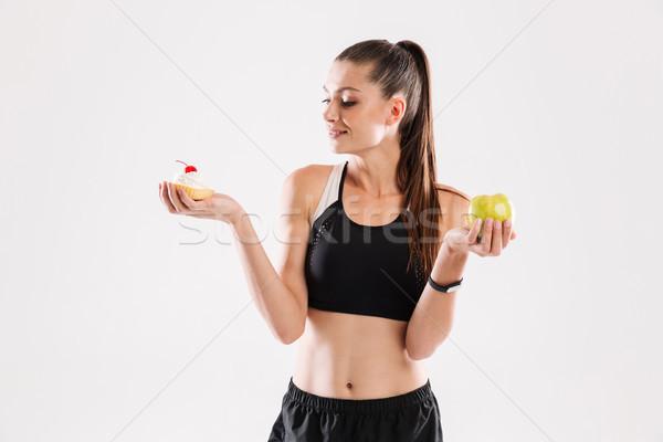 Stock photo: Portrait of a young slim sportswoman