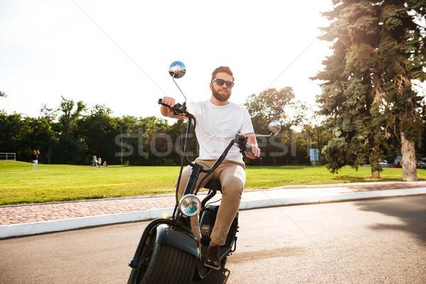 счастливым бородатый человека Солнцезащитные очки современных мотоцикле Сток-фото © deandrobot