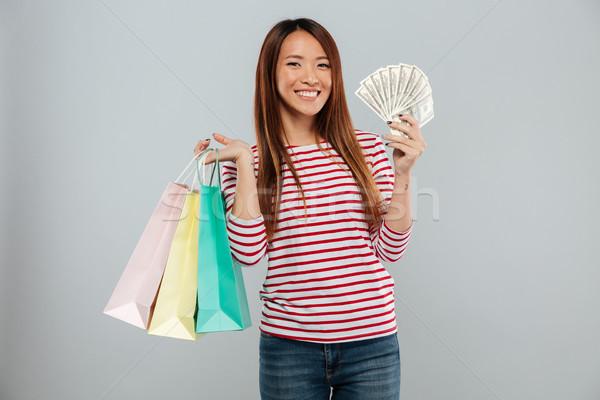快樂 亞洲的 女子 毛線衣 錢 商業照片 © deandrobot