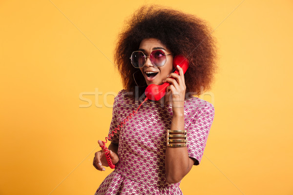 Portrait of an excited pretty afro american woman Stock photo © deandrobot