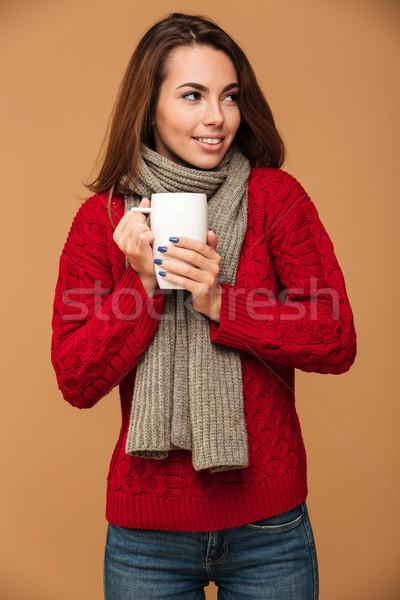 Cheerful caucasian lady drinking hot tea. Stock photo © deandrobot