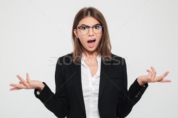 Portret onzeker jonge zakenvrouw pak bril Stockfoto © deandrobot