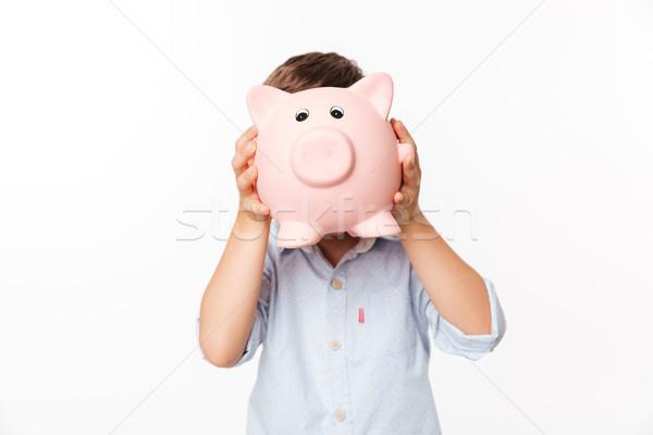 Portrait of a little kid covering his face Stock photo © deandrobot