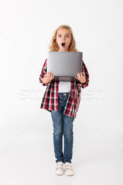 Full length portrait of a shocked little girl Stock photo © deandrobot