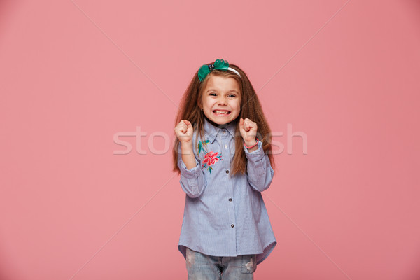 Smiling girl model in hair hoop and fashion clothes expressing h Stock photo © deandrobot