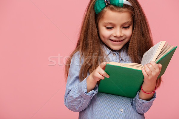 Close up portrait of lovely schoolgirl with long brown hair read Stock photo © deandrobot