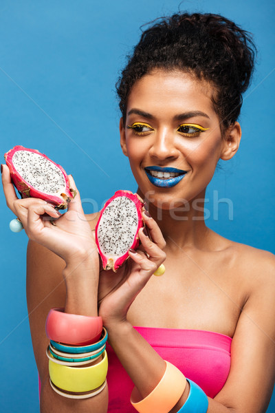 Portrait of smiling mulatto woman with bright cosmetics on face  Stock photo © deandrobot