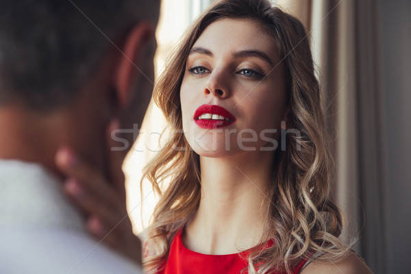 серьезный женщину обнять человека позируют Сток-фото © deandrobot