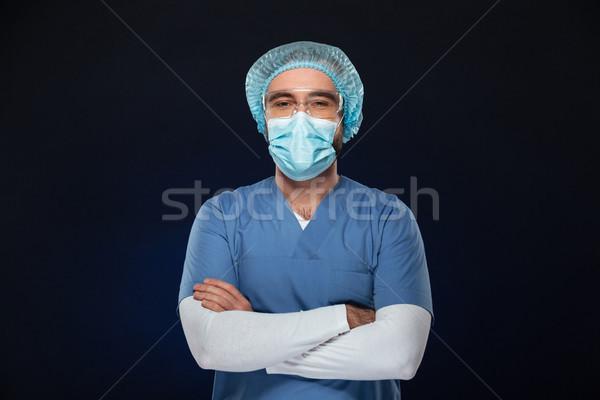 Ritratto maschio chirurgo indossare faccia Foto d'archivio © deandrobot