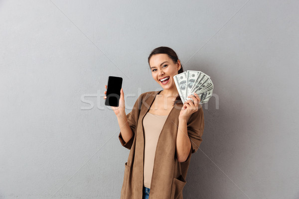 Portrait of a delighted young asian woman Stock photo © deandrobot