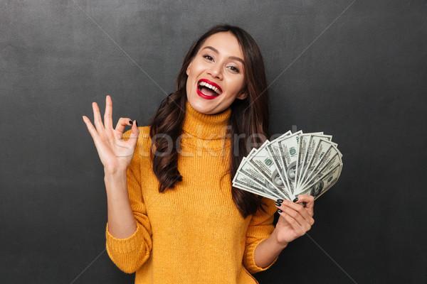 Feliz mujer suéter dinero Foto stock © deandrobot