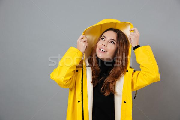 Portré mosolyog lány esőkabát pózol fej Stock fotó © deandrobot