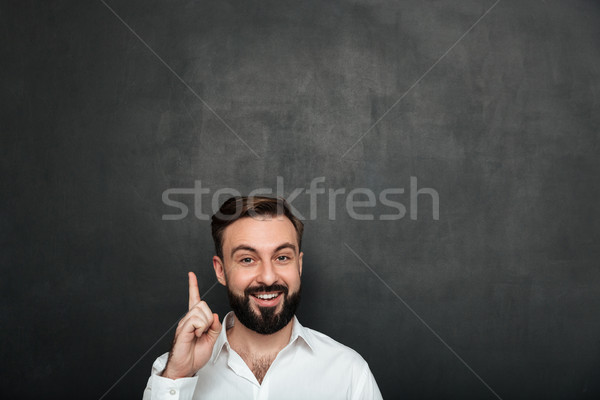 Cropped image of brunette businessman posing on camera with show Stock photo © deandrobot