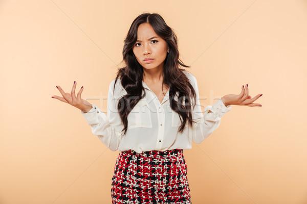Portré zavart ázsiai nő portré nő áll Stock fotó © deandrobot