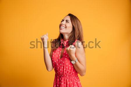 Portrait of a smiling satisfied girl talking Stock photo © deandrobot