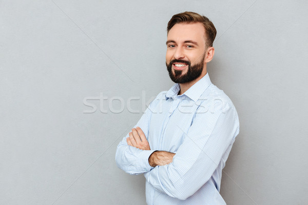 Pleased bearded man in business clothes with crossed arms Stock photo © deandrobot