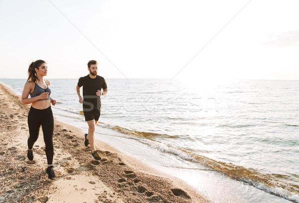 Jogging samen strand vrouw Stockfoto © deandrobot