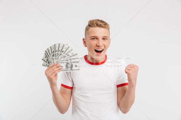 Portré mosolyog tizenéves fiú tart pénz bankjegyek Stock fotó © deandrobot