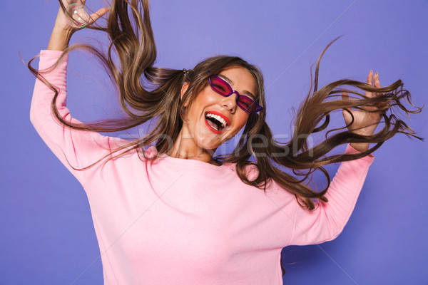 Portrait of teenage woman with two ponytails in sweatshirt weari Stock photo © deandrobot