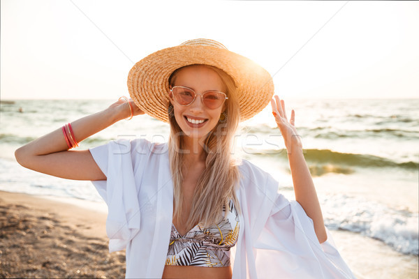 Image of gorgeous blonde woman 20s in summer straw hat and sungl Stock photo © deandrobot