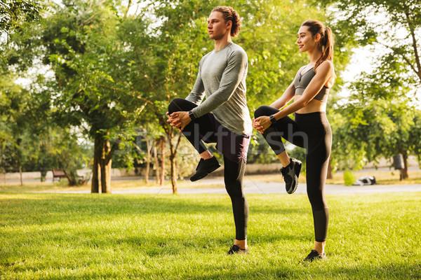 Photo athlétique homme femme 20s up Photo stock © deandrobot