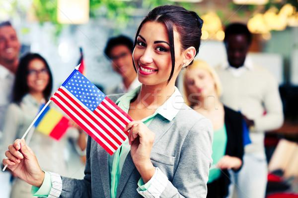 Patriótico empresária em pé EUA bandeira colegas Foto stock © deandrobot