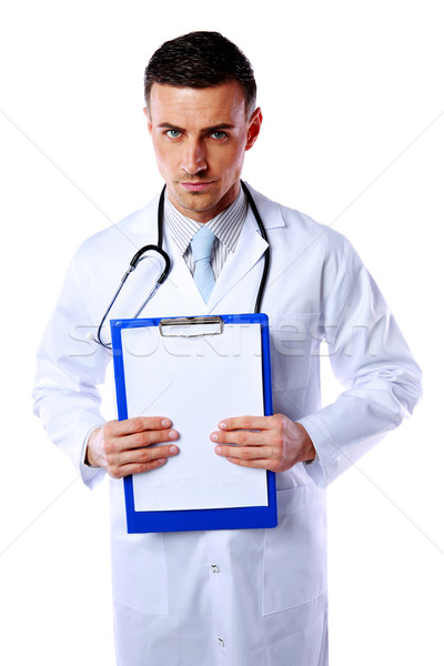 Male doctor holding empty clipboard isolated on white background Stock photo © deandrobot