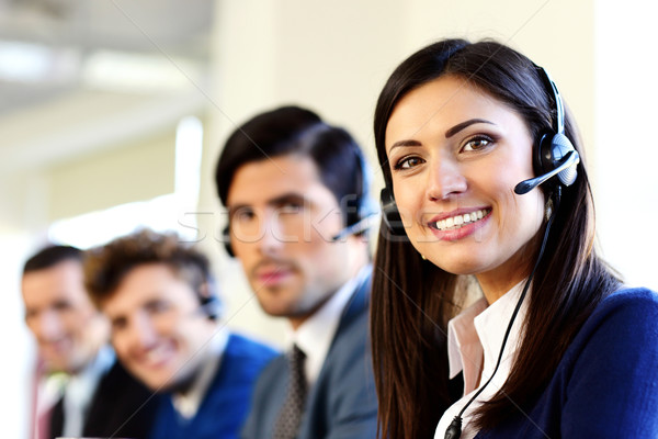 Smiling businesspeople in a call center office Stock photo © deandrobot