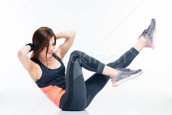 Sorridere fitness donna addominale isolato bianco sport Foto d'archivio © deandrobot