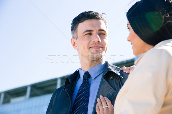 Happy couple flirting outdoors Stock photo © deandrobot