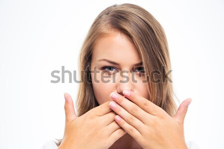 Young woman covering her mouth  Stock photo © deandrobot