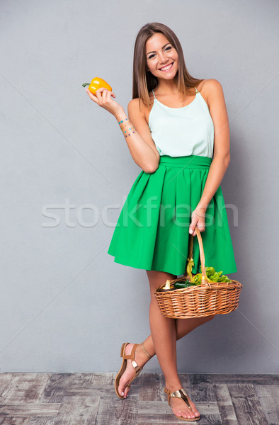 Woman holding basket with vegetables  Stock photo © deandrobot