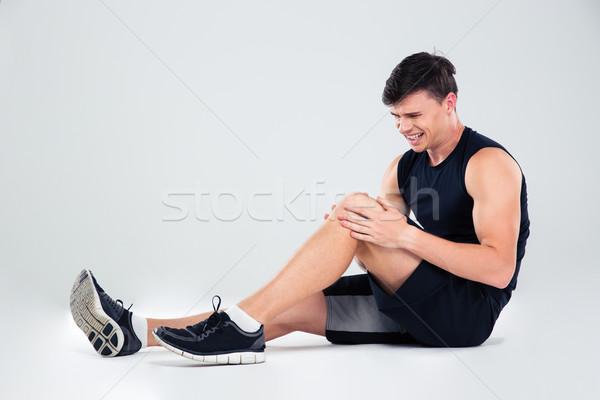 Fitness Mann Leiden Schmerzen Knie Porträt Stock foto © deandrobot