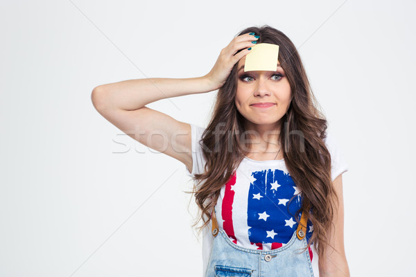 Happy woman with sticky note on forehead  Stock photo © deandrobot
