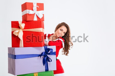 Laughing cute woman standing with arms folded Stock photo © deandrobot