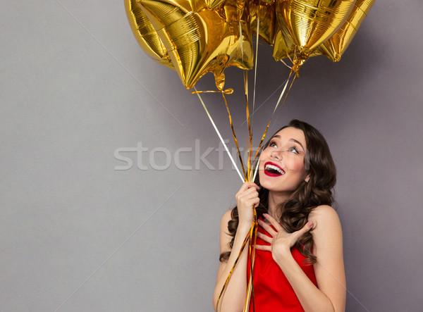 ストックフォト: 驚いた · 幸せ · 女性 · 赤いドレス · 風船