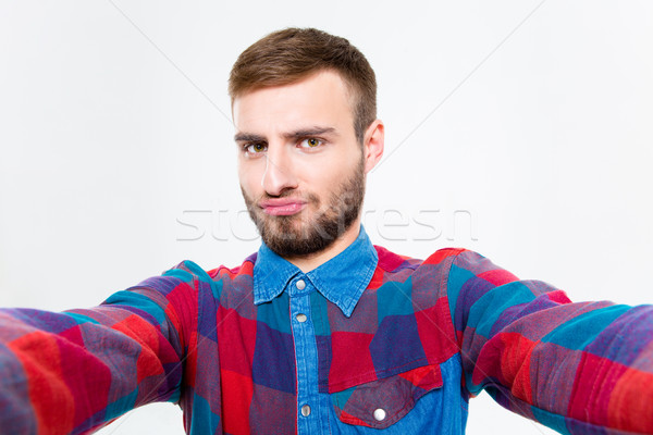 Selfie photo of attractive confident young man in plaid shirt  Stock photo © deandrobot