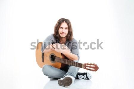 Séduisant jeune homme cheveux longs séance guitare Photo stock © deandrobot