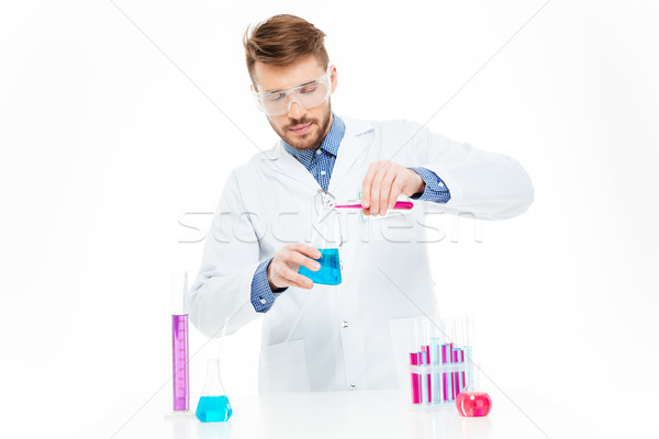 Adam kimyasallar yalıtılmış beyaz tıbbi Stok fotoğraf © deandrobot