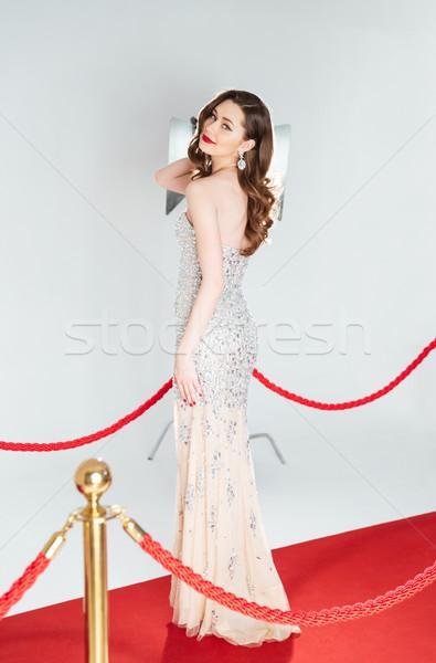 Heureux femme posant tapis rouge portrait Photo stock © deandrobot