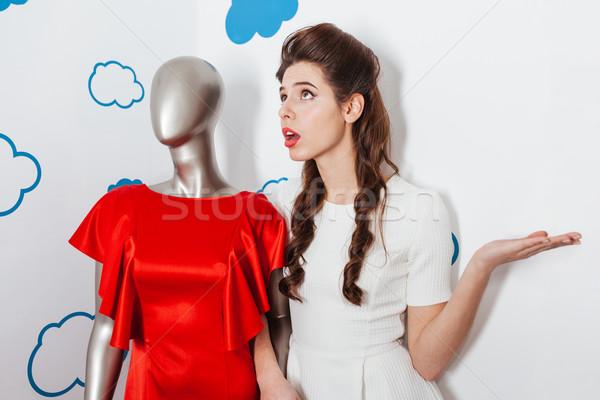 Woman talking with manikin Stock photo © deandrobot