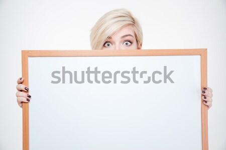 Blonde woman peeking from blank board Stock photo © deandrobot