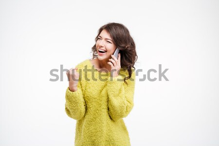 Successful woman talking on the phone Stock photo © deandrobot